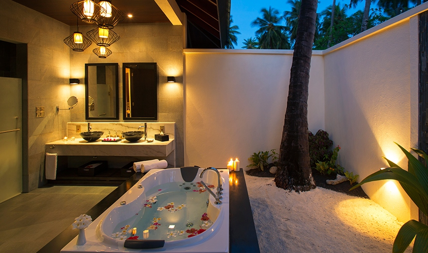 Romantic Open air bathroom at Atmosphere Kanifushi